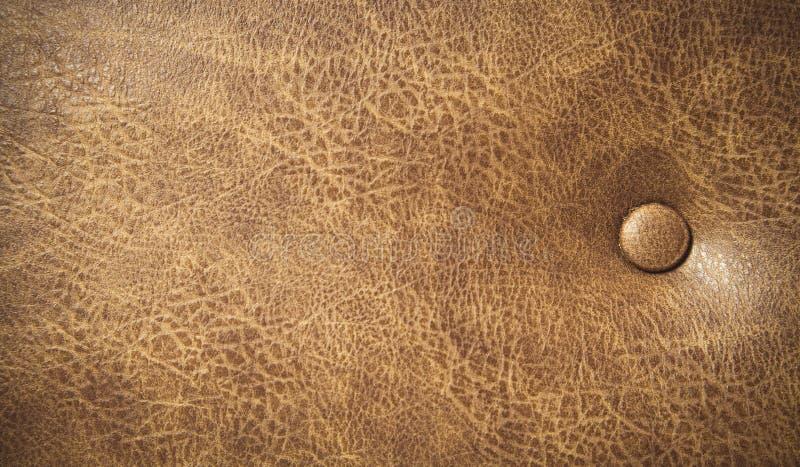 Предпосылка текстуры кожаного дивана Брауна стоковое изображение