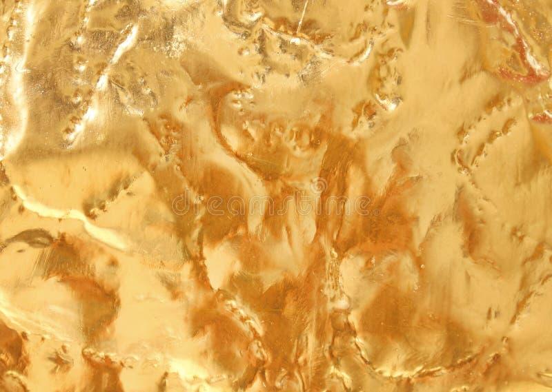 Предпосылка текстуры сияющего металла золота абстрактная с грубыми картинами стоковая фотография