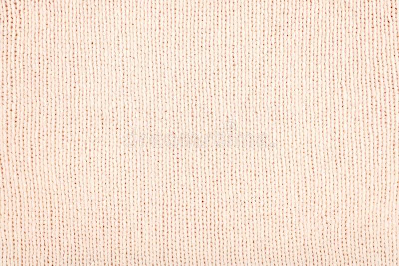 Предпосылка ткани пинка связанная светом Связанная шерстяная ткань подняла текстура Абстрактный конец текстуры свитера шерстей вв стоковые фотографии rf