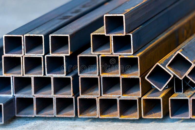 Предпосылка трубки металла квадрата высокуглеродистая для тяжелой индустрии стоковые фото