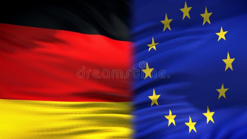 Предпосылка флагов Германии и Европейского союза, дипломатический и экономические отношения стоковая фотография rf
