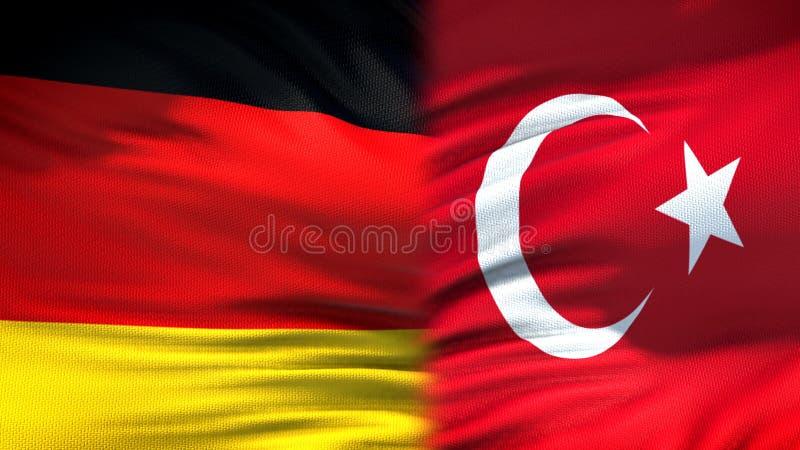 Предпосылка флагов Германии и Турции, дипломатический и экономические отношения стоковые фотографии rf