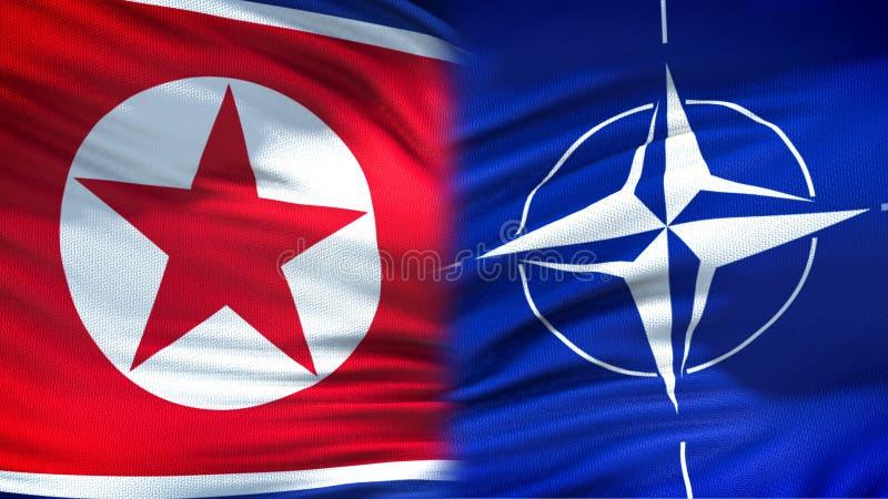 Предпосылка флагов Корейской Северной Кореи и НАТО, дипломатическое и экономические отношения стоковое изображение