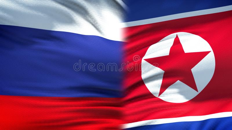 Предпосылка флагов России и Корейской Северной Кореи, дипломатический и экономические отношения стоковая фотография rf