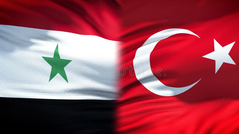 Предпосылка флагов Сирии и Турции, дипломатический и экономические отношения, безопасность стоковые изображения rf