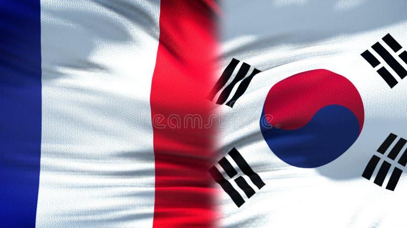 Предпосылка флагов Франции и Южной Кореи, дипломатический и экономические отношения стоковая фотография