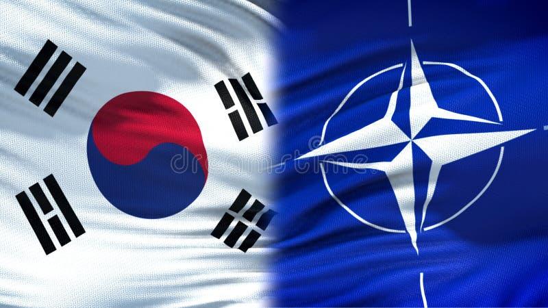 Предпосылка флагов Южной Кореи и НАТО, дипломатическое и экономические отношения стоковое изображение rf
