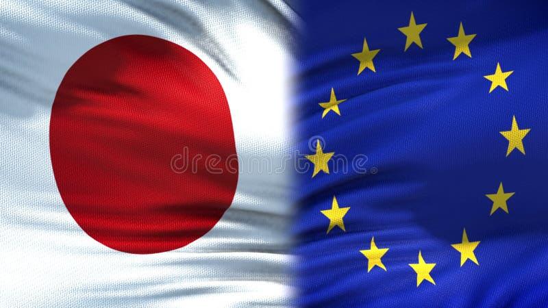Предпосылка флагов Японии и Европейского союза, дипломатический и экономические отношения стоковые фотографии rf