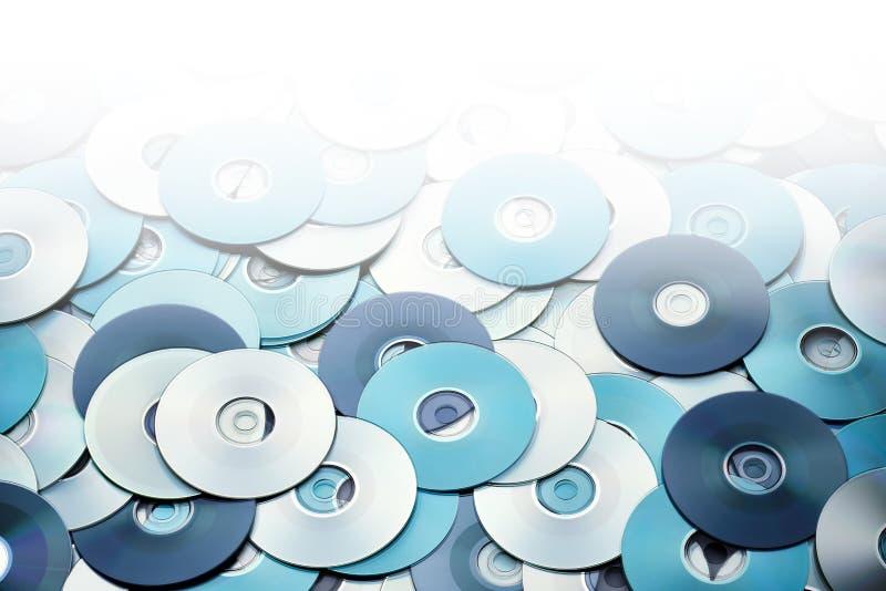 Предпосылка хранения данных серебряных голубых дисков DVD и CD стоковая фотография