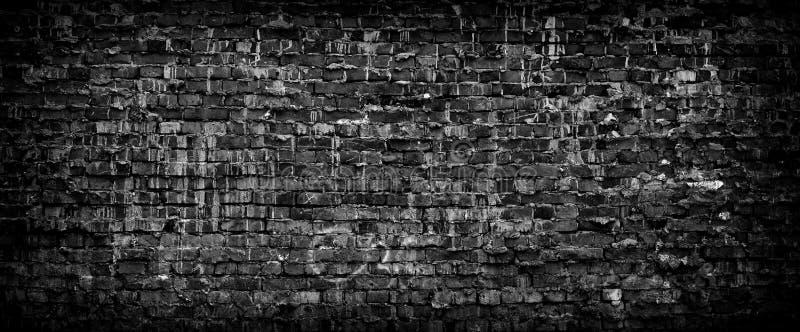 Предпосылка черной кирпичной стены grunge панорамная стоковое изображение rf