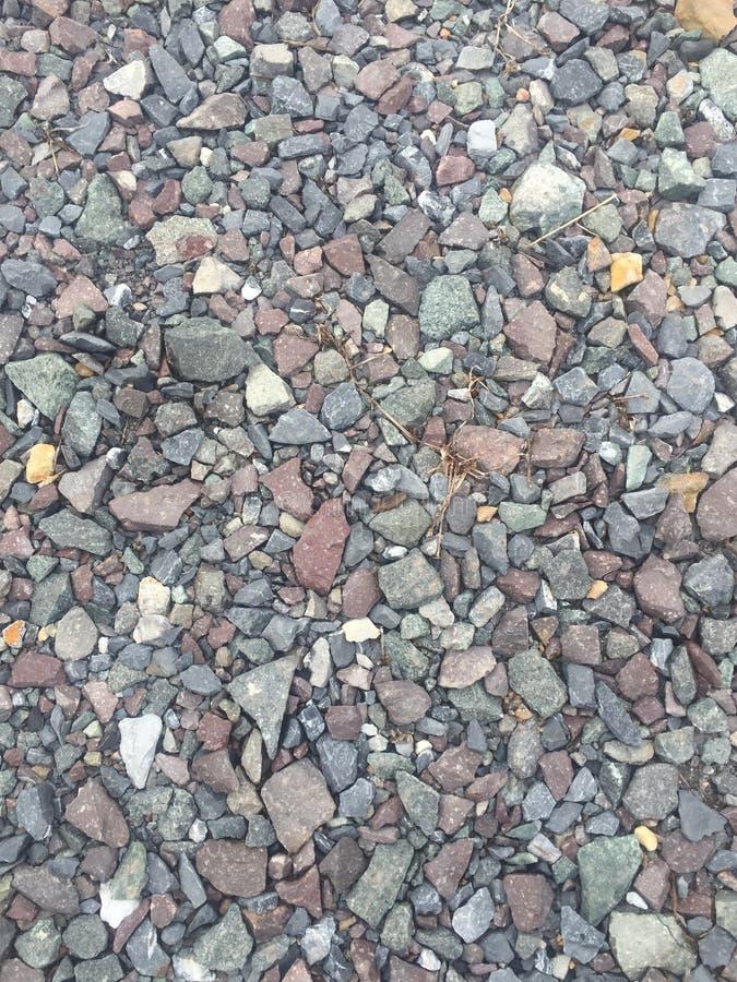 Предпосылка черной текстуры камня камешка славная естественная стоковые фотографии rf