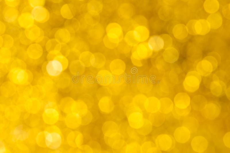 Предпосылка bokeh света золота нерезкости Аннотация стоковые изображения rf