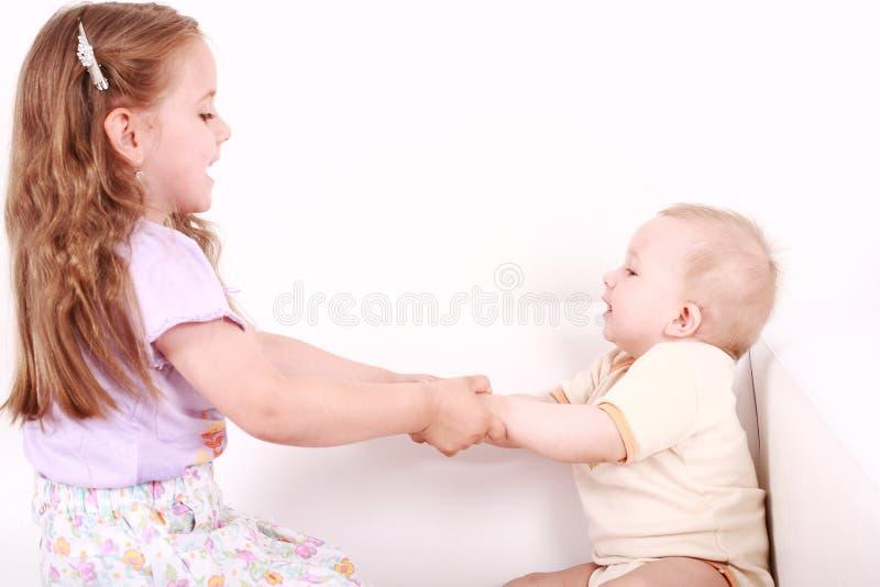 прелестный играть малышей стоковое фото rf