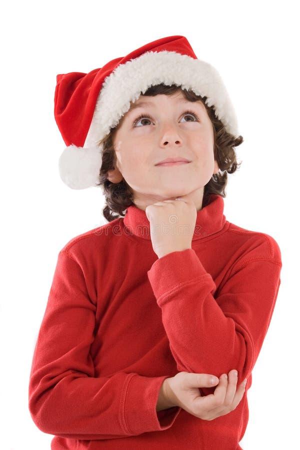 прелестный красный цвет шлема рождества мальчика стоковое изображение
