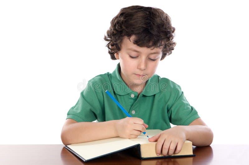 прелестный ребенок книги пишет стоковое фото rf