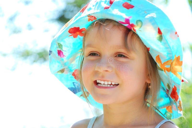 прелестный усмехаться девушки стороны стоковая фотография rf