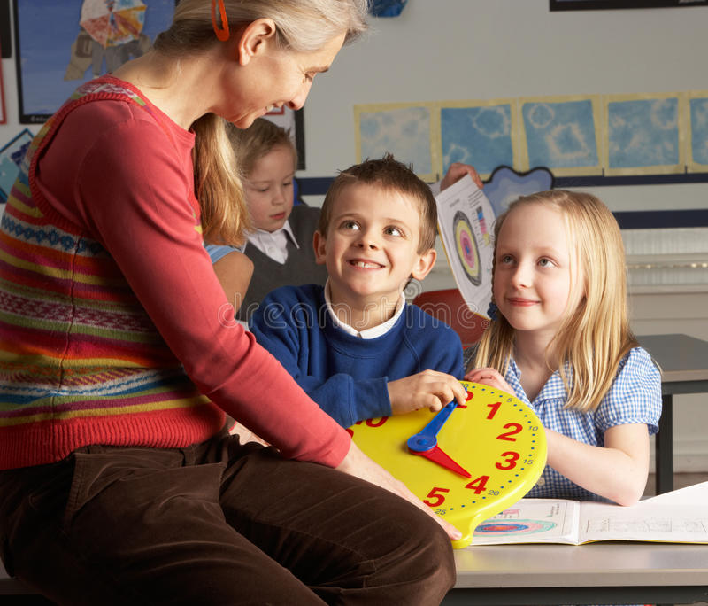 преподавательство учителя начальной школы детей женское стоковые изображения rf
