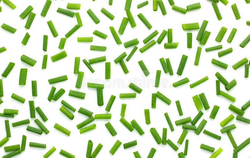 Прервал свежие зеленые луки изолированные на белой предпосылке, предпосылке лука стоковая фотография