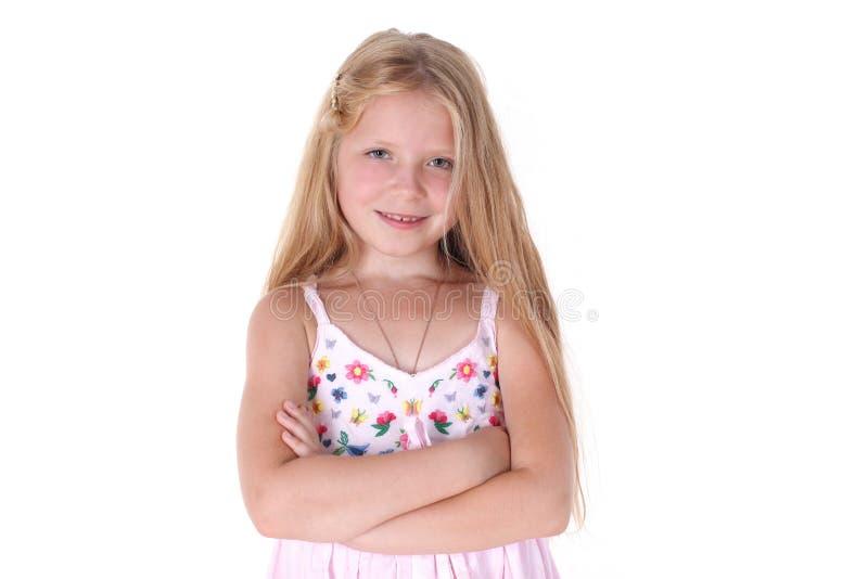 Прелестная маленькая девочка на белой предпосылке стоковое фото