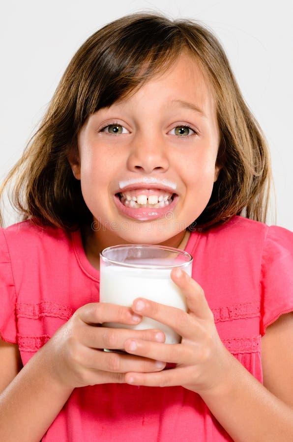 Прелестный ребенок с усиком молока стоковая фотография rf