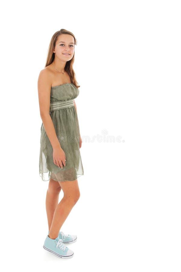 Предназначенная для подростков девушка стоя в студии стоковое изображение rf