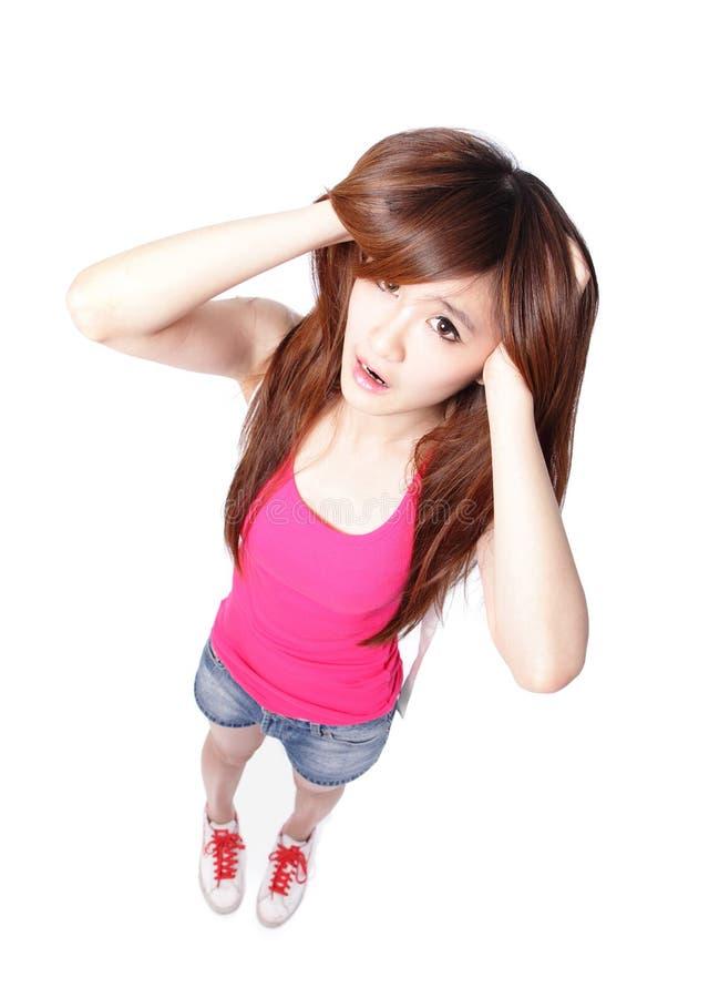 Предназначенная для подростков девушка думает стоковые изображения