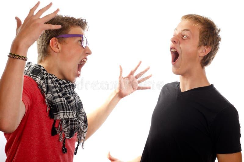 Предназначенный для подростков конфликт мальчика стоковая фотография