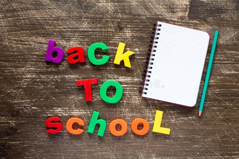 Предложение назад к школе и пустой тетради стоковые фото