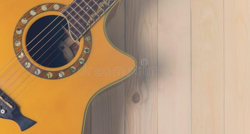 Предпосылка акустической гитары страны в винтажном тоне стоковые изображения rf