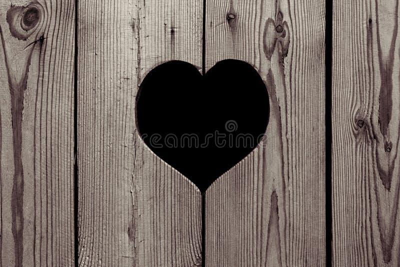 Предпосылка Брайна деревянная с сердцем сбор винограда текстуры цветастой дома детали внешней старый стоковое фото