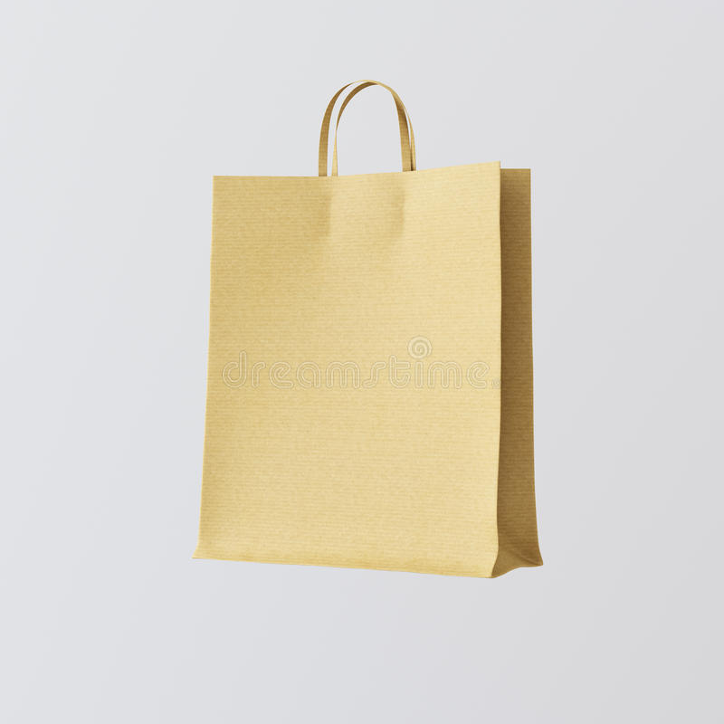 Предпосылка бумажной сумки Kraft крупного плана изолированная разбивочная белая пустая Материалы текстуры модель-макета сильно де стоковое фото
