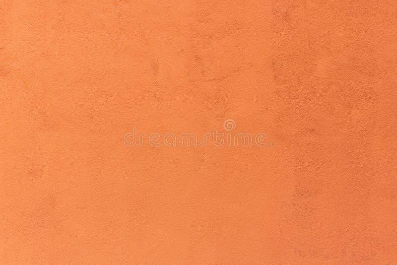 Предпосылка винтажного оранжевого цемента цвета стоковые изображения