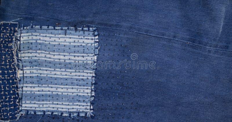 Предпосылка заплатки джинсов, заплатка джинсовой ткани стоковые фото