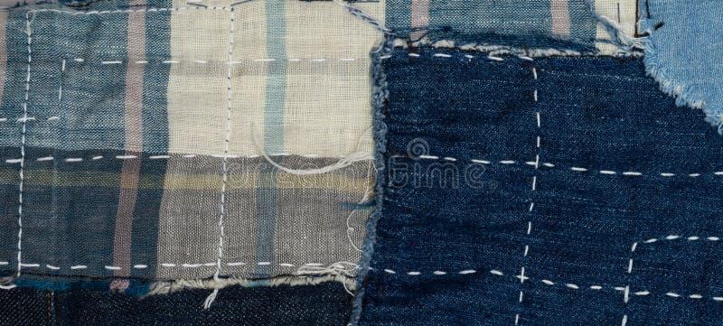 предпосылка заплатки, заплатка джинсовой ткани стоковое изображение
