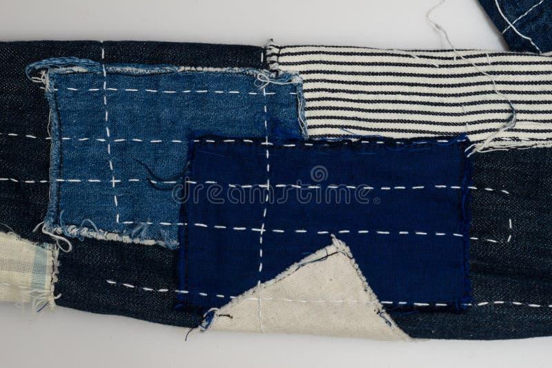 предпосылка заплатки, заплатка джинсовой ткани стоковое фото rf