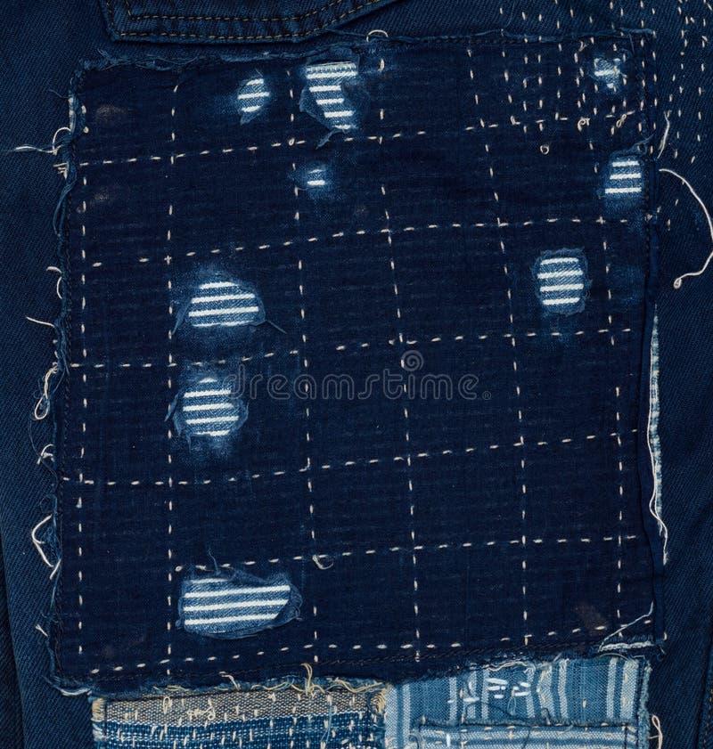 предпосылка заплатки, заплатка джинсовой ткани стоковое фото