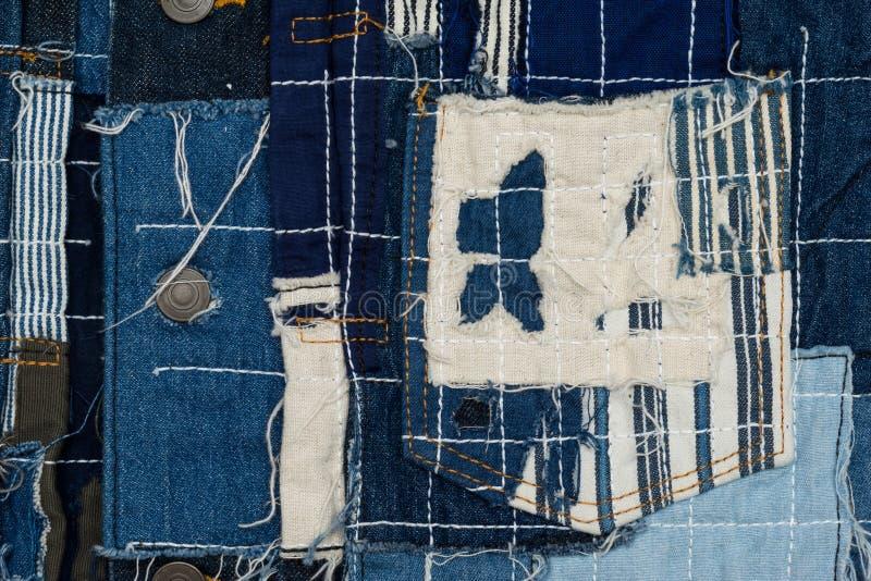 предпосылка заплатки, заплатка джинсовой ткани стоковые фото