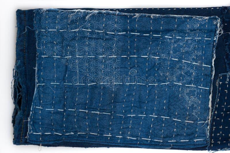 предпосылка заплатки, заплатка джинсовой ткани стоковые изображения