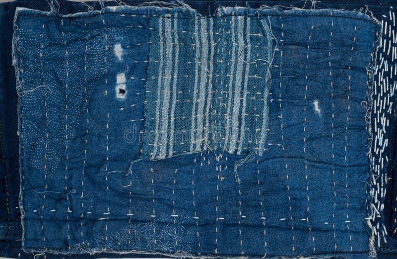предпосылка заплатки, заплатка джинсовой ткани стоковая фотография rf