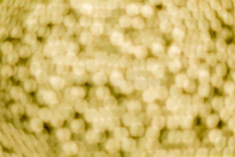 Предпосылка и bokeh золота запачканные шариком стоковые фотографии rf