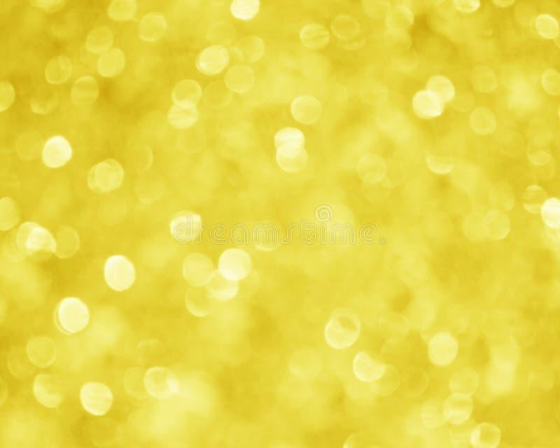 Предпосылка нерезкости желтого золота - изображение запаса Xmas стоковые фото
