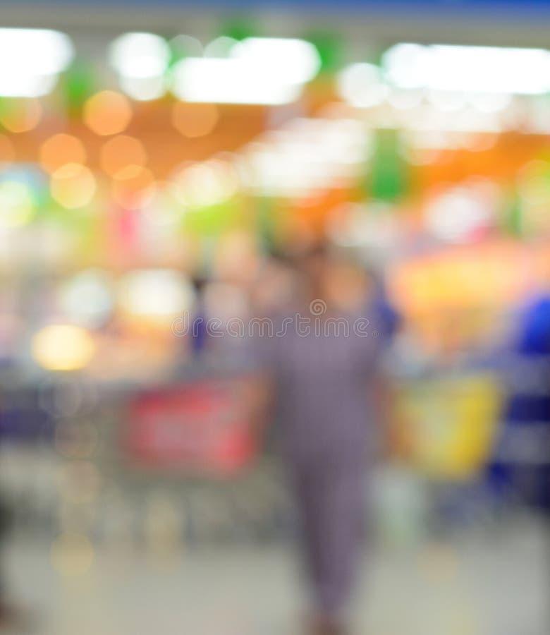 Предпосылка нерезкости магазина супермаркета стоковое фото rf