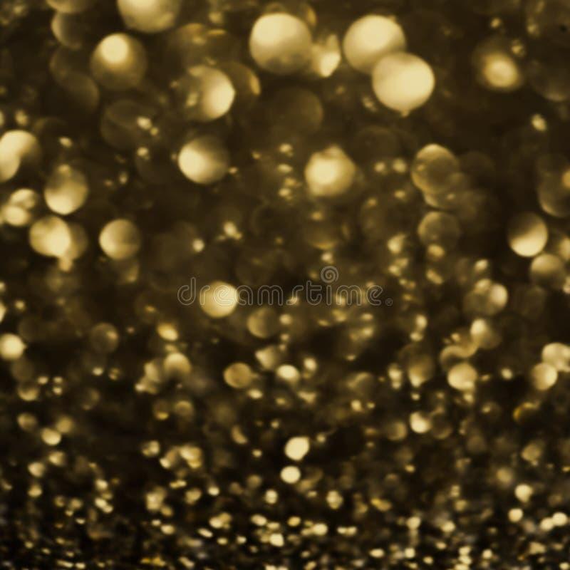 Предпосылка нерезкости темного золота праздничная Абстрактная ноча мерцала bri стоковые фото