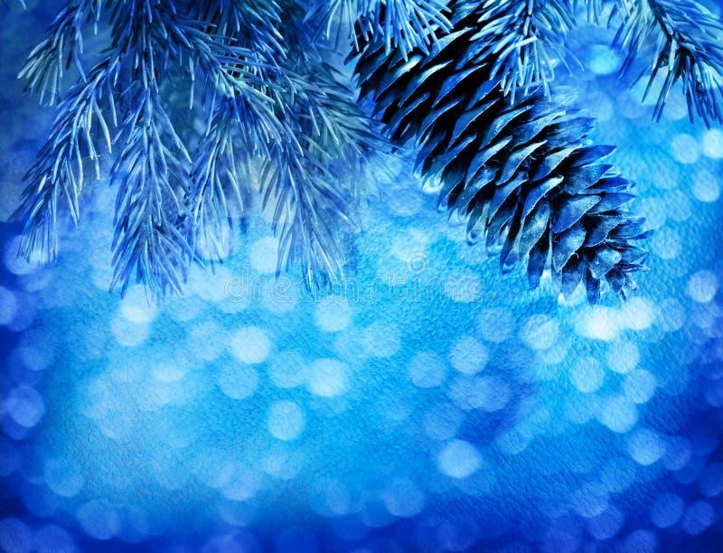 Предпосылка рождества нерезкости голубая с елью стоковое фото rf