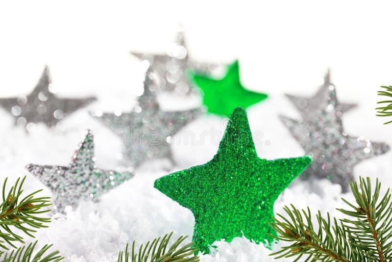 Предпосылка рождества с зелеными звездами стоковое изображение