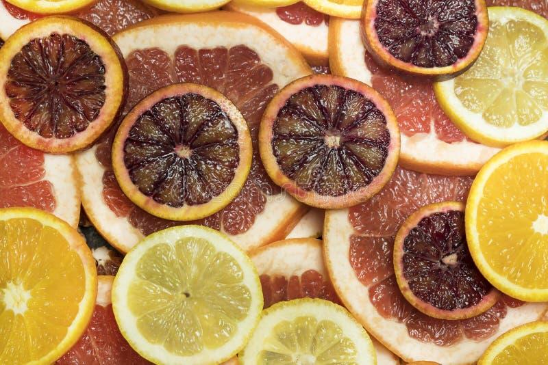 Предпосылка свежих отрезанных цитрусовых фруктов стоковое фото