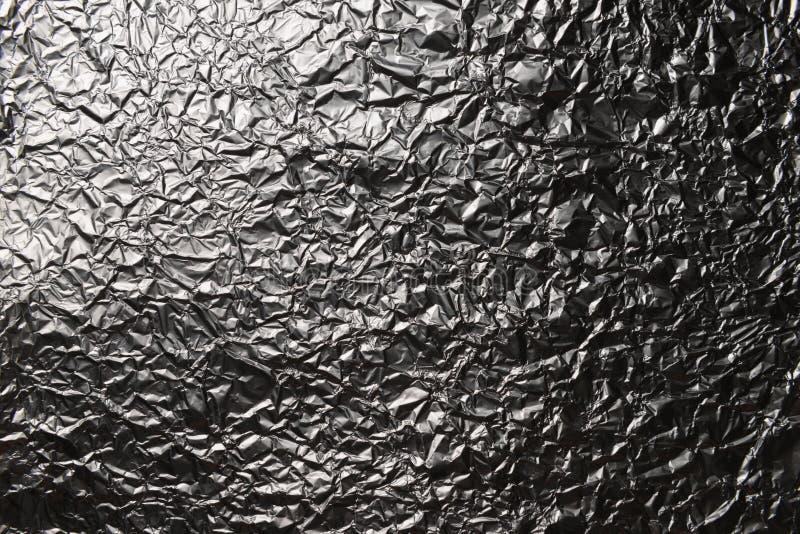 Предпосылка серебряной фольги с сияющей скомканной поверхностью стоковое изображение rf