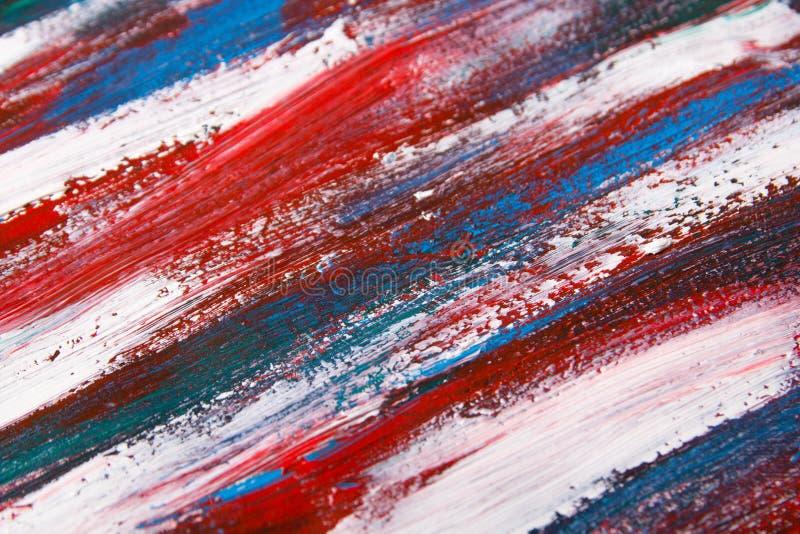 Предпосылка текстуры - близкая вверх голубых и красных ходов краски стоковые фото