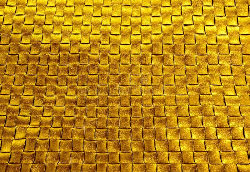 Предпосылка текстуры золота заплетенная бронзой кожаная стоковая фотография rf