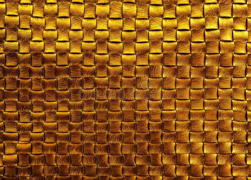 Предпосылка текстуры золота заплетенная бронзой кожаная стоковое фото rf